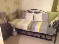 Wayfair Milano day bed and bedside table.
