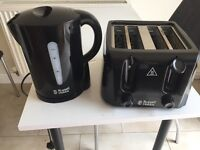 Russell Hobbs Black Kettle and 4 slice toaster.