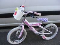 """GIRLS 16"""" WHEEL RALEIGH BIKE WITH FITTED BASKET IN GREAT WORKING ORDER AGE 4+"""
