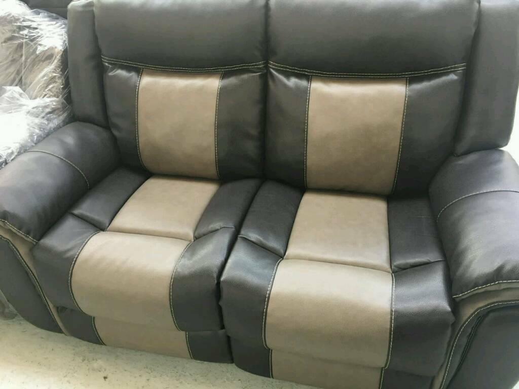 Brown and grey 3 2 seater reclining sofain Sheffield, South YorkshireGumtree - Ex display designer endurance leather dark brown and grey 3 2 seater reclining sofa in new condition for more information please contact us on. 07831107621.We can deliver anywhere in the UK For lowcost