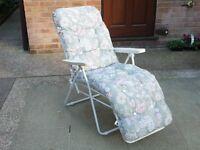 Reclining sun lounger with full length padded cushion.