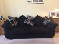 Three seater black sofa