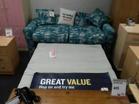 2 seater sofa bed upholstered in teal floral fabric - British Heart Foundation sco39426