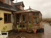 Large conservatory including 1 set of patio doors and 11 windows (8.7 m by 3 m approx)