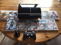 PlayStation 3 + 9 games + wireless headset