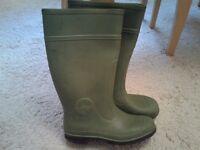 Green Wellington boots.