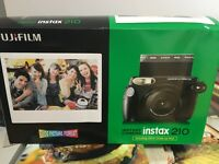 Fujifilm Instax210 Instax Camera. Not used and still in original box.
