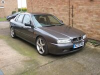 MODIFIED ROVER 620ti PETROL TURBO CAR AND GARAGE LOAD OF ASSOCIATED SPARES