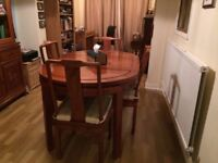 Beautiful rosewood dining table and 4 chair set. Imported from Far east. Excellent condition