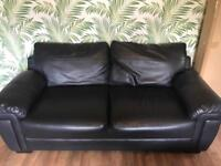 Large black faux leather sofa