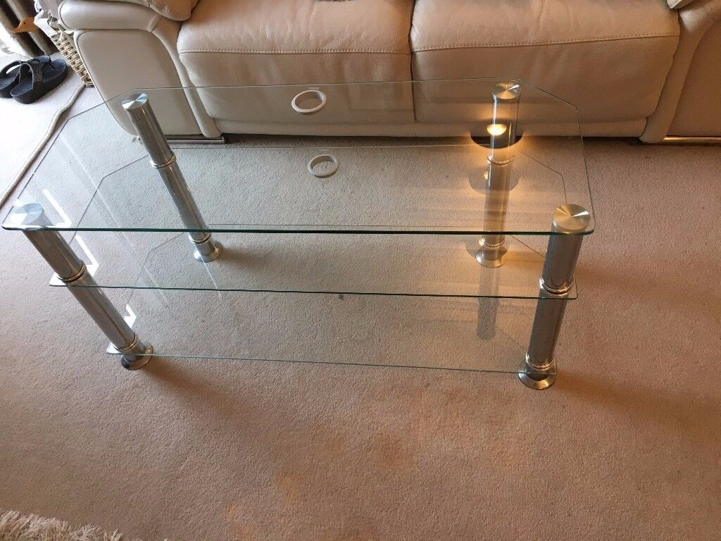 "JOHN LEWIS GLASS/STEEL TV STAND. GOOD CONDITION. Width 40"" x Depth 162 x Height 10"""