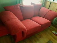 Red 2 seater sofa and foot puff