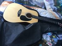 Excellent condition Eastwood LA125 acoustic guitarwith bag, strap, strings and pitch pipe