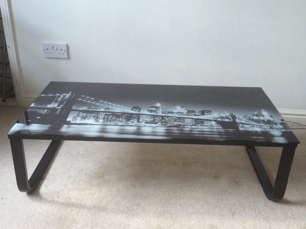 New York glassed topped coffee table