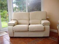 Cream 2 seater leather sofa