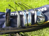 Teenagers golf clubs + free cover. (Some unused clubs still in original packaging)