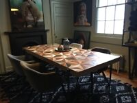 Wooden artisan dining table from Graham Green
