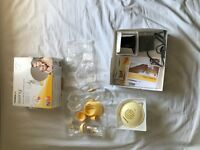 Used once Medela swing breast pump + 2x 27mm breast shields
