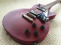 Epiphone Les Paul Studio electric guitar with stand