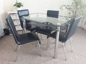 GLASS TABLE + 4 CHAIRS FOR SALE