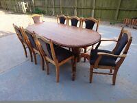 pine oval table with 6 side chairs and 2 carver end chairs by Ducal