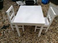 Wooen little table and two little chairs