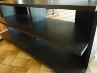 very nice black tv wooden stand/unit on castors(4 shelf)(118 cms wide)(height 52 cms)(depth 40 cms)
