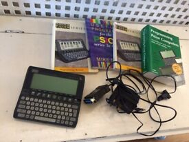 Psion 3a pocket size computer with books