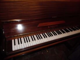 small upright piano by squire