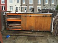 Free wood container with industrial steel shelving for uplift from premises..