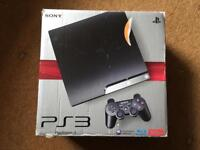 Boxed PS3 with 2 games , controller and PS3 eye.