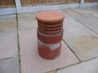 Terracotta capped chimney pot