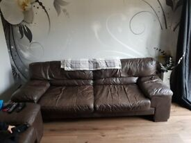 A brown leather 3 seater and a single chair both very comfy and looked after.