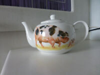 Bone china teapot decorated with farmyard animals.
