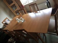 Beech Extending Dinning table with six chairs.