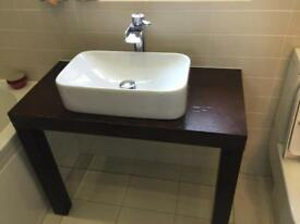Wooden bathroom washstand with basin and waterfall mixer tap