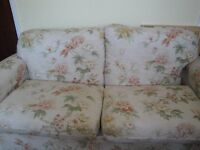 Pretty two seater sofa bed. Useful piece of furniture that doubles up as a fold away sprung bed.