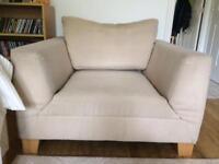 Cream/neutral armchair
