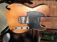 This is a telecaster style guitar that has beeen aged