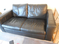 Next Black leather two seated settee.