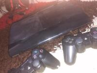 PLAYSTATION 3 With 15 Games, x2 Controllers and Gaming Headset