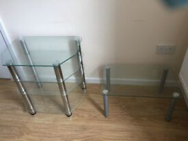 A SET OF GLASS TABLES