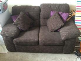Two seater brown couch