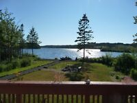 Lake front cottage plus a rental income cottage with 38 acres