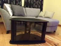 TV stand (black), one glass shelf and glass doors. Half Circle shaped top
