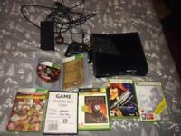 Xbox 360 slim + games + wireless controller