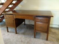 Large wooden desk with drawers