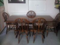 Dark Wood (?oak) Dining table and six chairs