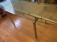 Extending tempered glass dining table seats 8+