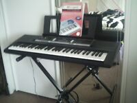 yamaha psr;e243 digital keyboard and stand, with head phones. as new
